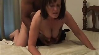Mature hottie gets a doggystyle by a black dude