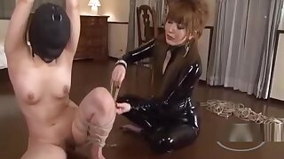 Asian Girl In Mask Bondaged Getting Her Pussy Rubbed By Mistress On The Floor In The Roo