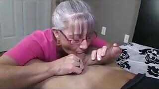 Greyhaired whore sucking a lucky dude