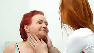 Redhead Russian sexiest granny has sex with russian girl
