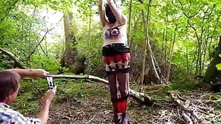 Slave hooded gagged and tits tied in wood