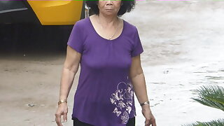 Braless Granny walking in rain