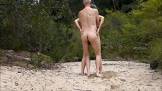 Old couple is filmed on the beach