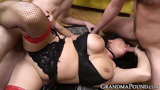 Grandma in sexy lingerie deepthroats dicks in spitroast orgy