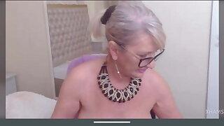 Latin blonde granny with saggy tits masturbates pussy