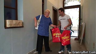 Busty blonde grandma pleases young stranger